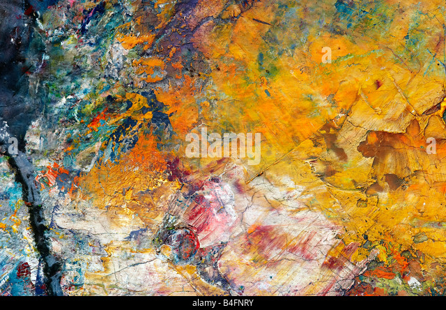 Extreme close-up - macro - of the dry oil paints on the painter´s palette - pastose color coating - Stock Image