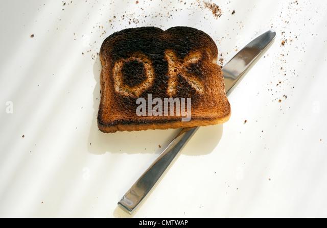 burnt toast with OK on it - Stock Image