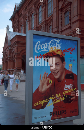 Russia former Soviet Union Moscow Coca Cola poster ad near Red Square multinational company - Stock Image
