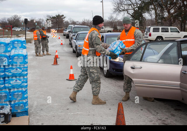 Flint, Michigan - Members of the Michigan National Guard distributed bottled water to Flint residents at Fire Station - Stock Image