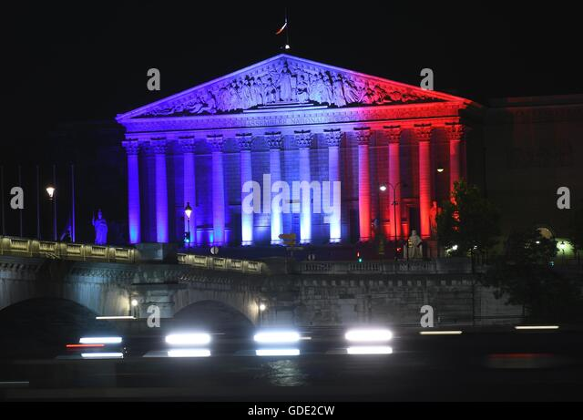 Paris. 15th July, 2016. The Palais Bourbon, headquarters of the French National Assembly, is illuminated in the - Stock-Bilder