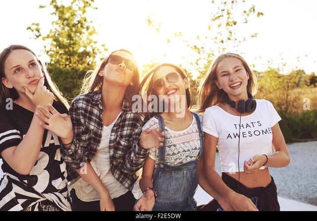 Teenagers having fun on a summer day, sun flare - Stock Image