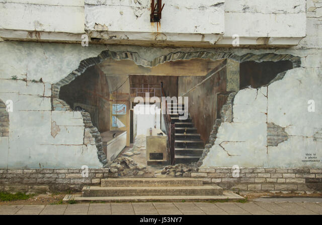 Swanage, UK -  12 May: Detail of a mural on a wall of a delelict building by Swanage Pier.  General view of the - Stock Image