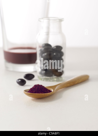 Acai juice, capsules and powder - Stock Image