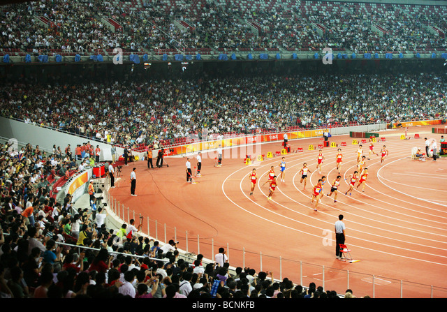 Chinese atheletes competing in 100m run during Good Luck Beijing Game held in Bird's Nest, Beijing, China - Stock Image