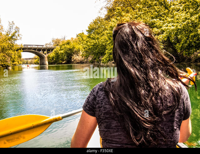 Young woman canoeing on Barton Creek, Austin, Texas - Stock Image