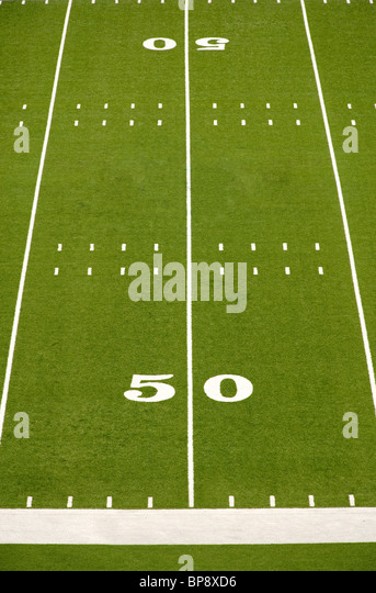 Closeup of 50 yard line on American football field. - Stock Image