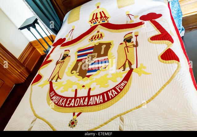 Hawaii Oahu Hawaiian Honolulu Iolani Palace inside interior bed bedroom quilt seal Kingdom of Hawaii - Stock Image