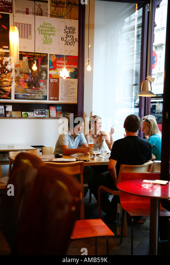 Aug 2008 - People sitting at the trendy Das Mobel cafe Vienna Austria - Stock Image