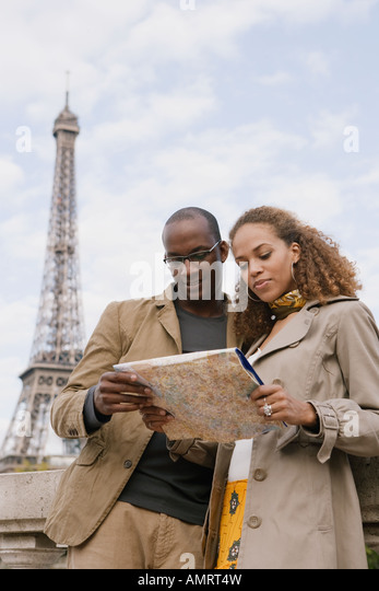 African couple looking at map - Stock-Bilder