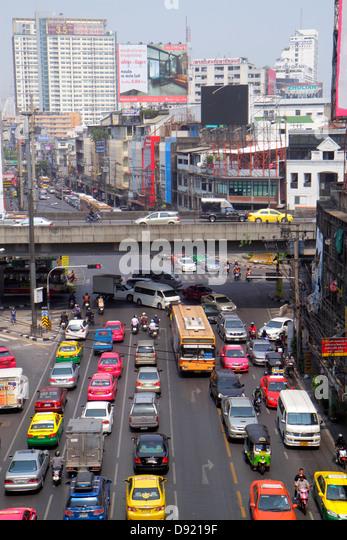 Bangkok Thailand Ratchathewi Pratunam traffic urban bus taxi cab buildings city skyline aerial - Stock Image