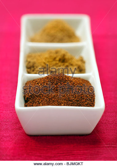 Three different sorts of curry powder - Stock Image