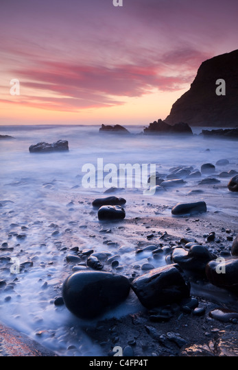 Twilight on the rocky beach at Duckpool on the North Cornish Coastline, Cornwall, England. Spring (March) 2011. - Stock Image