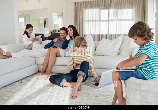 Family using electronics gadget - Stock Image