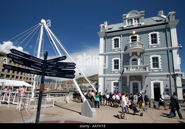 south africa cape town Victoria Albert waterfront swing bridge harbour office building destination panel sign post - Stock Image