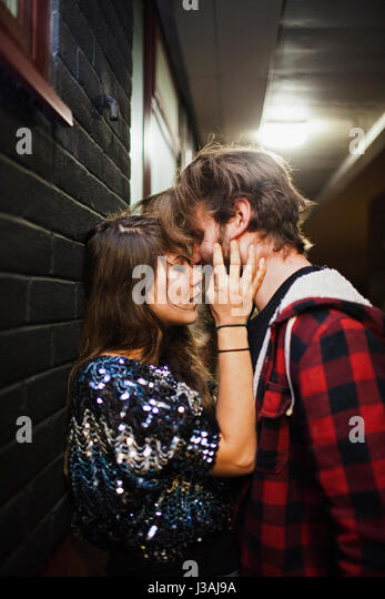 Young couple embracing on a balcony - Stock Image