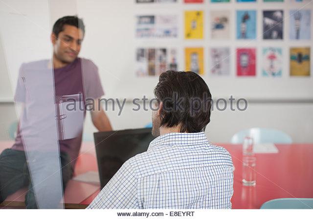 Men talking in meeting - Stock Image