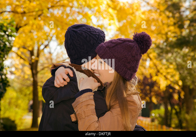 Young couple hugging in autumn park, Vienna, Austria - Stock Image