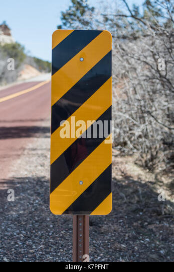 Caution Sign on Side of Road in desert - Stock Image