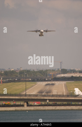 Scot Airways Dornier Do 328 110 taking off at London City Airport in the crosswind 2004 - Stock Image