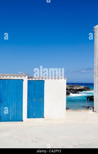 Es calo escalo Formentera white balearic architecture blue wooden door - Stock Image