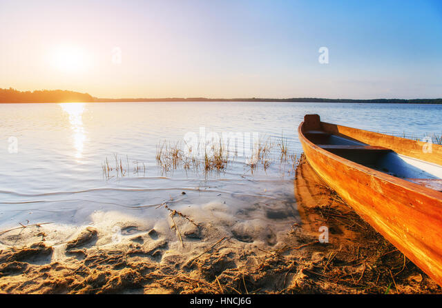 boat on the lake at sunset - Stock Image