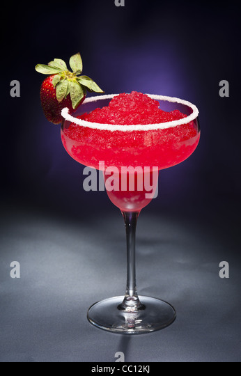Strawberry margarita Cocktail in front of different colored backgrounds - Stock-Bilder