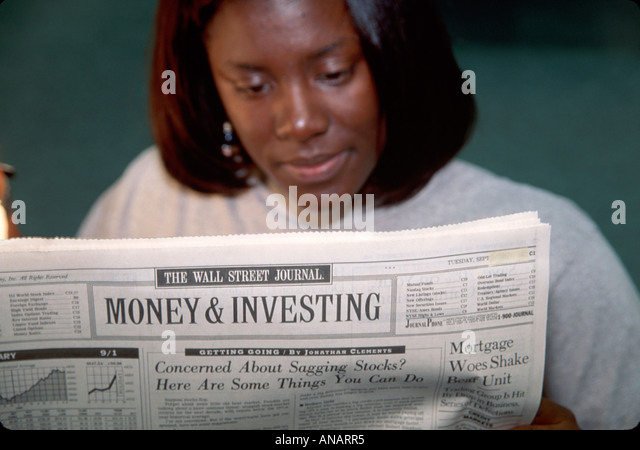 New Jersey Paramus Black female student Wall Street Journal business finance newspaper financial investment - Stock Image