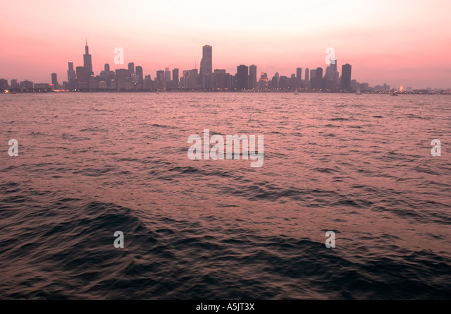 Chicago Skyline at sunset from Lake Michigan Illinois - Stock Image
