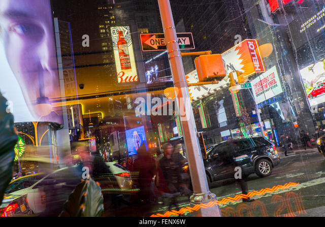 Advertising billboards at night, Times Square, New York, USA - Stock Image