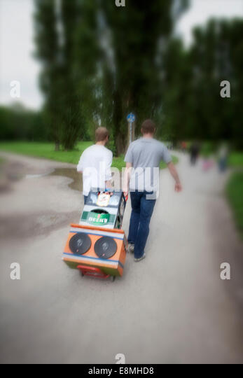 Teens preparing a party in the park, Hanover-Linden, Lower Saxony, Germany, Europe, - Stock-Bilder