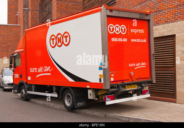 A TNT express courier van in Norwich , Norfolk , England , Great Britain , Uk - Stock Image