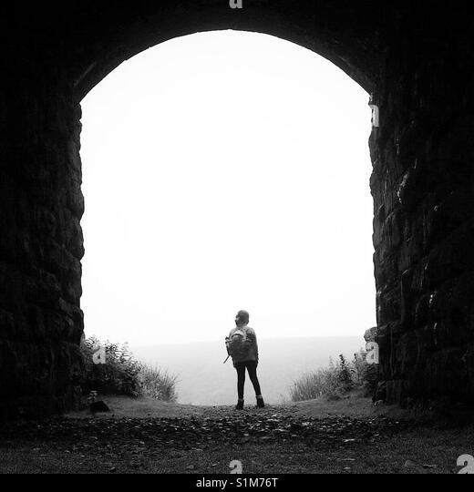 Girl under a railway bridge at Ribblehead, Yorkshire Dales, England. - Stock Image