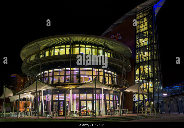 The RNLI Lifeboat college in Poole, Dorset, illuminated at night - Stock Image