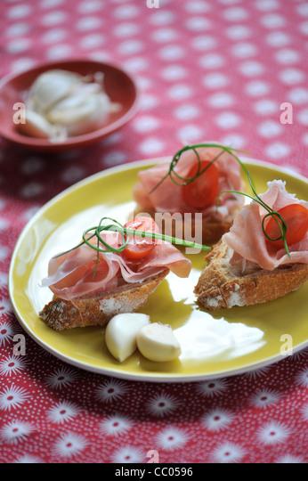 Raw Ham Toasts - Stock Image
