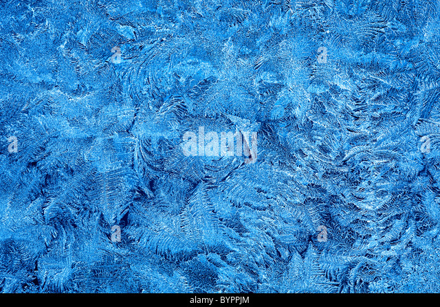 Frost patterns on window glass in winter - Stock-Bilder
