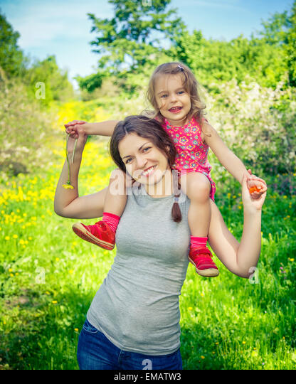 Mother and daughter in the park - Stock-Bilder