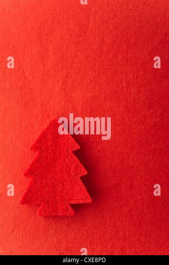 Christmas tree shape on red background - Stock-Bilder