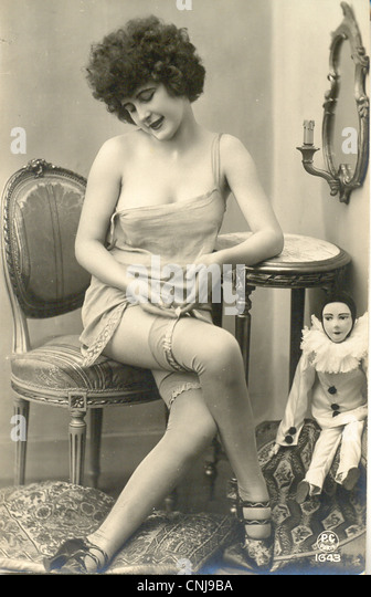 French postcard of provocative young lady - Stock-Bilder