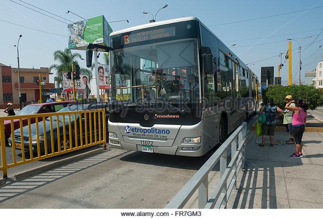 Lima Peru - Metropolitano bus service on dedicated lanes through the city. - Stock Image
