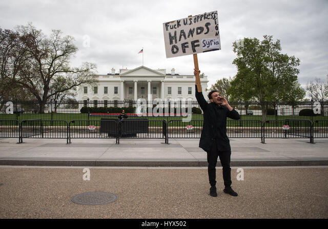 Washington, District of Columbia, USA. 7th Apr, 2017. Protestors gather in front of the White House against the - Stock Image