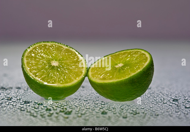 lime sliced in half - Stock-Bilder