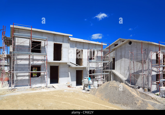 Building of new two-story white concrete house with stairs and balcony - Stock Image
