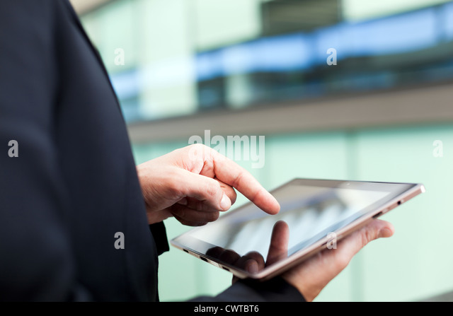 Business man working with a digital tablet - Stock Image