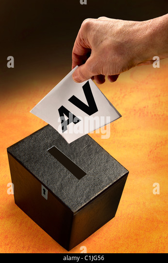 alternative voting.Ballot box and hand of voter. - Stock Image