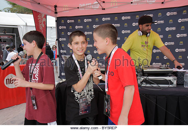 Miami Beach Florida Super Bowl XLIV Week NFL football product promotion dj deejay boy microphone rapping - Stock Image