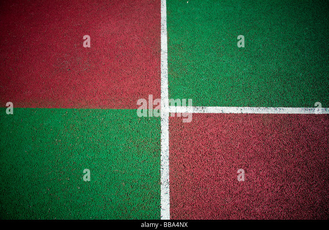 Abstract colours from an outdoor all weather tennis court tarmac - Stock Image