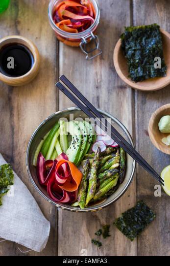 Spring Vegetable Sushi Bowls on Unfinished Wood - Stock Image