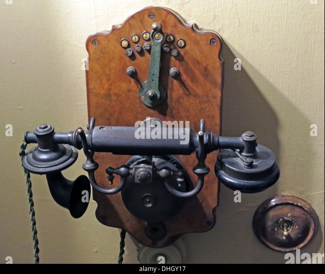 Old fashioned Edwardian telephone, Dunham Massey NT, Altrincham, Cheshire, England , UK - Stock Image