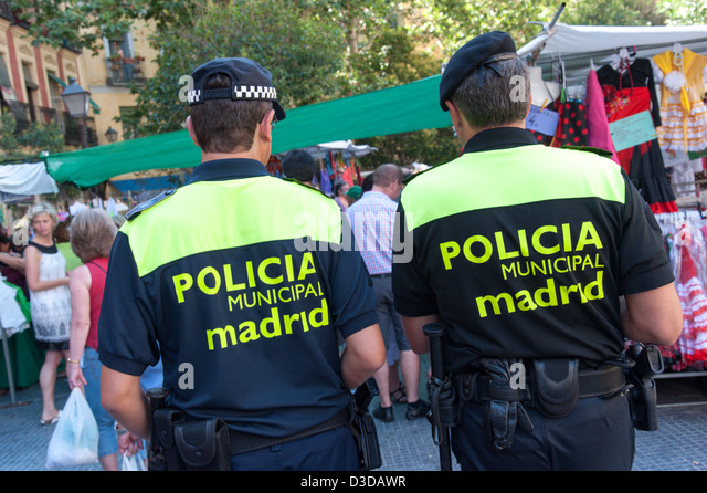 Policia Municipal patrolling the Rastro market, Madrid, Spain - Stock-Bilder